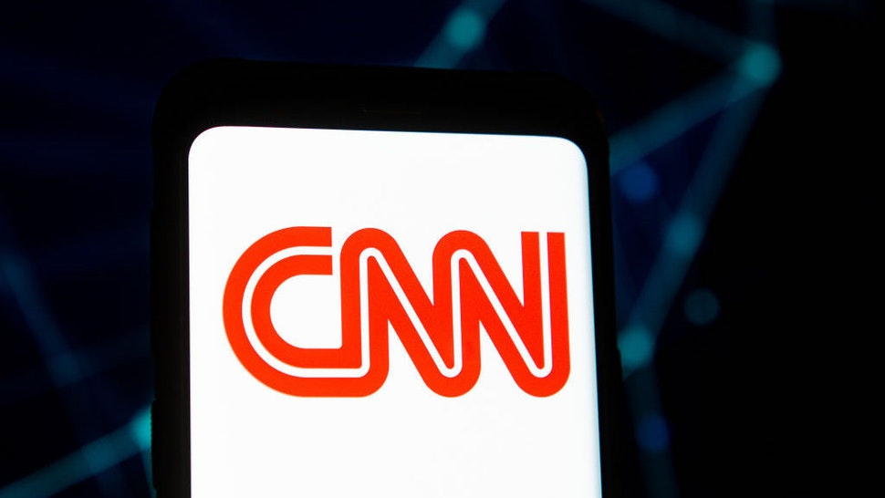 POLAND - 2020/03/23: In this photo illustration a CNN logo seen displayed on a smartphone. (Photo Illustration by Mateusz Slodkowski/SOPA Images/LightRocket via Getty Images)