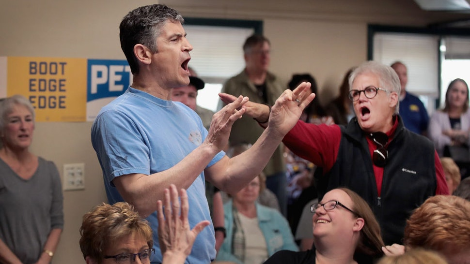 FORT DODGE, IOWA - APRIL 16: A woman shouts down a man making anti-gay remarks as Democratic presidential candidate and South Bend, Indiana Mayor Pete Buttigieg was hosting a town hall meeting at the Lions Den on April 16, 2019 in Fort Dodge, Iowa. This was Buttigieg's first visit to the state since announcing that he was officially seeking the Democratic nomination during a rally in South Bend on Sunday. (Photo by Scott Olson/Getty Images)