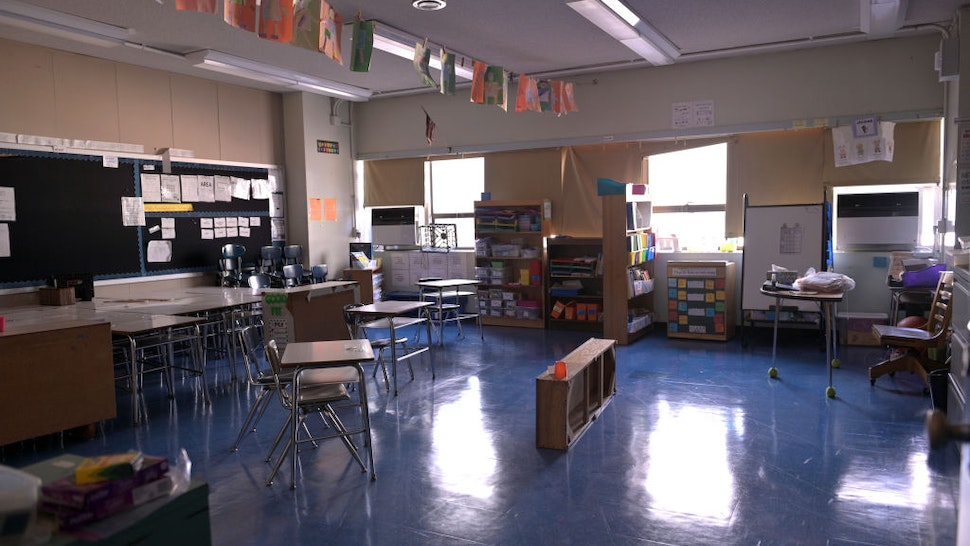NEW YORK, NEW YORK - NOVEMBER 19: A classroom is empty with the lights off on what would otherwise be a blended learning school day on November 19, 2020 at Yung Wing School P.S. 124 in New York City. NYC Mayor Bill DeBlasio had to return the nation's largest district had to all-remote teaching/learning as of today, with an indefinite outlook for reopening.