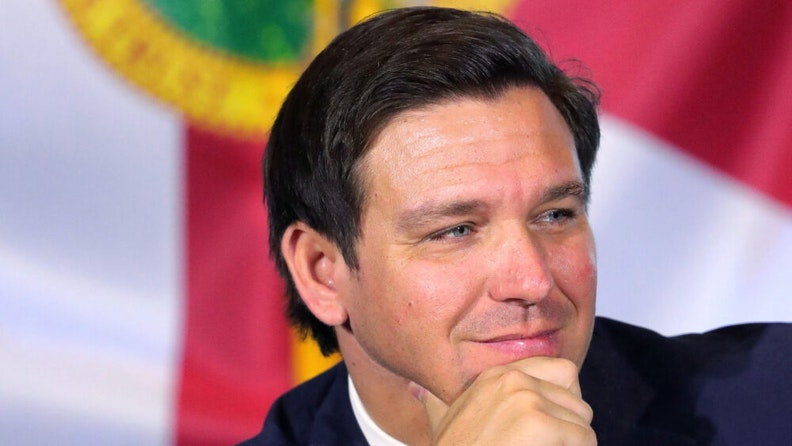 Governor Ron DeSantis listens during a roundtable discussion with theme park leaders about safety protocols and the impact of the coronavirus pandemic, Wednesday, August 26, 2020. Executives from Walt Disney World, Universal Orlando and SeaWorld Orlando participated.
