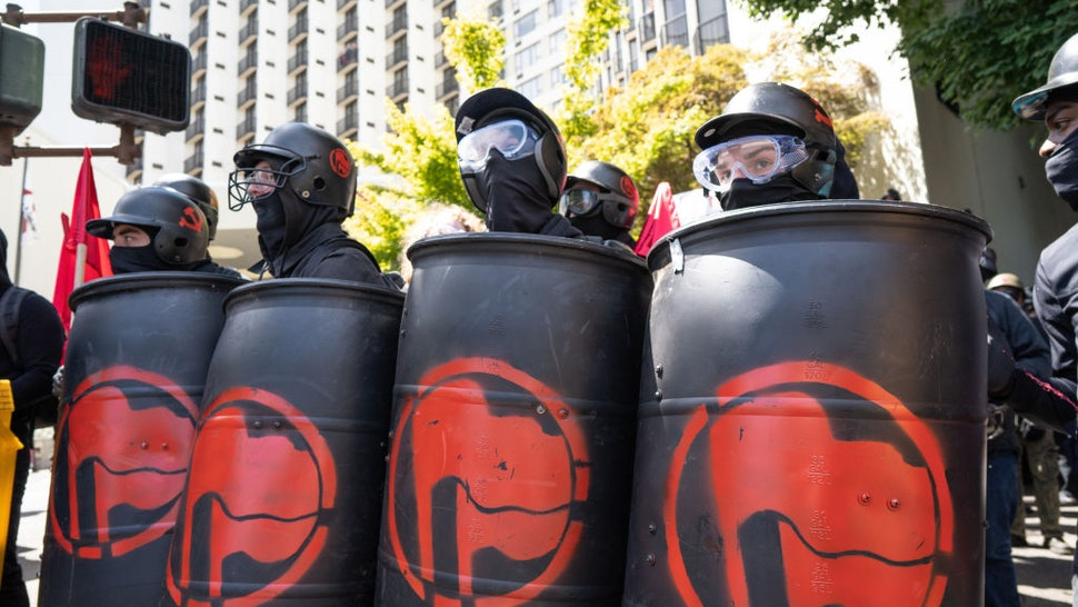 DOWNTOWN, PORTLAND, OREGON, UNITED STATES - 2018/08/04: Members of Antifa watch police and far right protesters during the Patriot Prayer Rally.