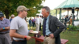 Vermont Governor Phil Scott greets voters following a debate with Vermont Democratic gubernatorial challenger Christine Hallquist September 14, 2018 at the Tunbridge World's Fair in Tunbridge, Vermont.