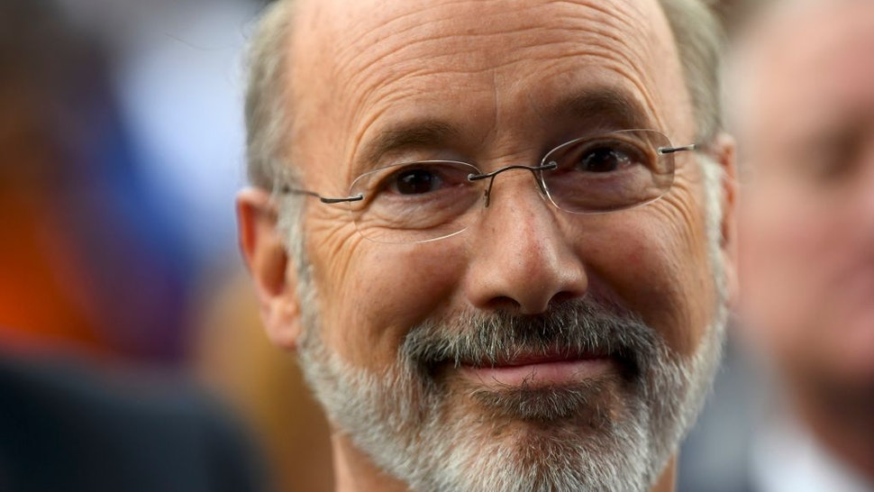 Pennsylvania Governor Tom Wolf reacts while listening to former President Barack Obama speak during a campaign rally for Wolf and Senator Bob Casey (D- PA) on September 21, 2018 in Philadelphia, Pennsylvania.