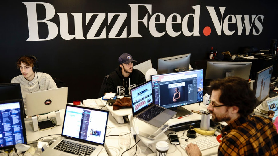 NEW YORK, NY - DECEMBER 11: Members of the BuzzFeed News team work at their desks at BuzzFeed headquarters, December 11, 2018 in New York City. BuzzFeed is an American internet media and news company that was founded in 2006. According to a recent report in The New York Times, the company expects to surpass 300 million dollars in earnings for the 2018 fiscal year. (Photo by Drew Angerer/Getty Images)