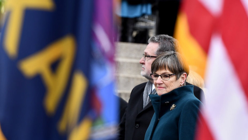 Laura Kelly sworn in as Kansas governor, promising a new chapter after partisan fights