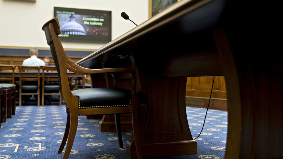An empty chair sits at a witness table before a House Judiciary Committee hearing on oversight of the report by Special Counsel Robert Mueller in Washington, D.C., U.S., on Tuesday, May 21, 2019. The White House moved to shield former Counsel Don McGahn from testifying before Congress, asserting a broad immunity to compelled testimony as Democrats investigate President Donald Trump's efforts to curb Mueller's Russia probe.