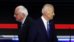 MIAMI, FLORIDA - JUNE 27: Democratic presidential candidates Sen. Bernie Sanders (L) (I-VT) and former Vice President Joe Biden pass each other on stage during the second night of the first Democratic presidential debate on June 27, 2019 in Miami, Florida. A field of 20 Democratic presidential candidates was split into two groups of 10 for the first debate of the 2020 election, taking place over two nights at Knight Concert Hall of the Adrienne Arsht Center for the Performing Arts of Miami-Dade County, hosted by NBC News, MSNBC, and Telemundo.
