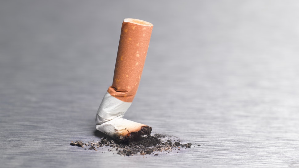 Final cigarette stubbed out, end of smoking
