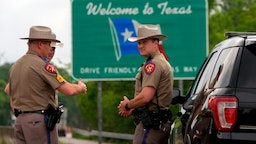 Texas State troopers patrol I-10 across the border from Louisiana on March 30, 2020 in Orange, Texas.