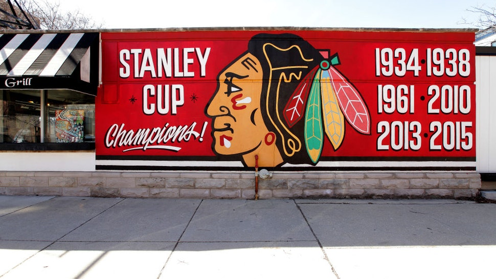 A Chicago Blackhawks 'Stanley Cup Champions' mural is displayed on the side of the Palace Grill Restaurant in Chicago, Illinois on March 7, 2020.