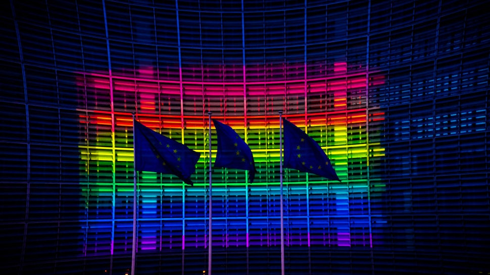 European Commission headquarters lit up in the colours of the rainbow flag to support International Day Against LGBT in Brussels, Belgium on May 16, 2020.