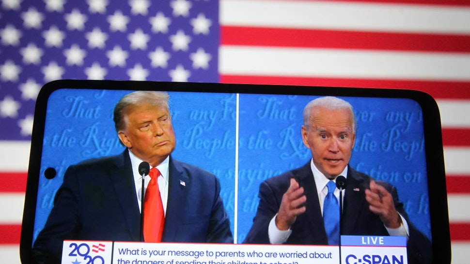 In this photo illustration the US President Donald Trump and Democratic presidential candidate and former US Vice President Joe Biden are seen during the final presidential debate displayed on a screen of a smartphone.