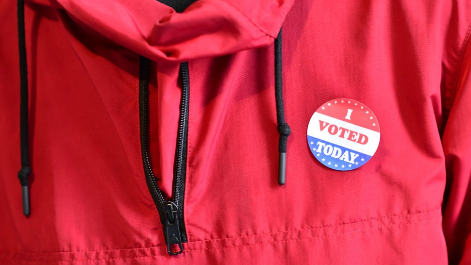 """A voter wears an """"I VOTED TODAY"""" sticker after casting his ballot at the Philadelphia City Hall satellite polling station on October 27, 2020 in Philadelphia, Pennsylvania."""