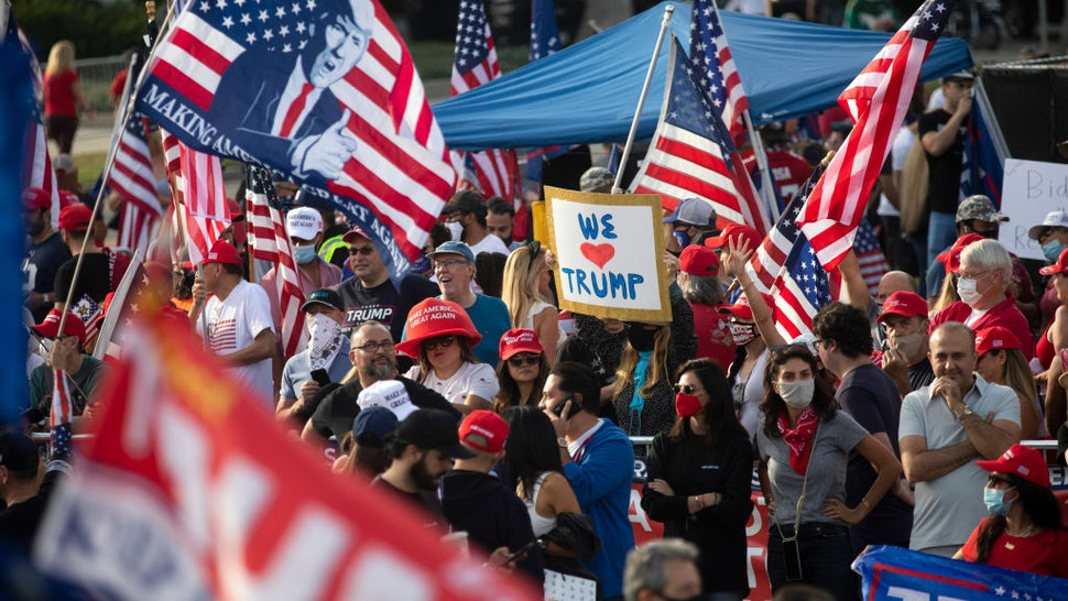 A large crowd chants four more years during a Pro Trump rally on Santa America Blvd and Beverly Blvd in Beverly Hills days before the Presidential election. on Saturday, Oct. 31, 2020.