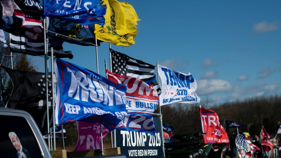 A truck supporting President Donald Trump flies flags as it drives past fellow supporters demonstrating across the street from a venue where Democratic U.S. Vice Presidential nominee Sen. Kamala Harris (D-CA) will hold a campaign event on the eve of the general election on November 2, 2020 in Bethlehem, Pennsylvania.