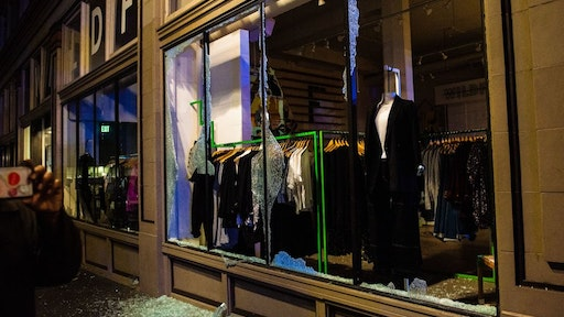 "A clothing store is vandalized as police confront protesters in Portland, Oregon on November 4, 2020, during a demonstration called by the ""Black Lives Matter"" movement, a day after the US Presidential Election."