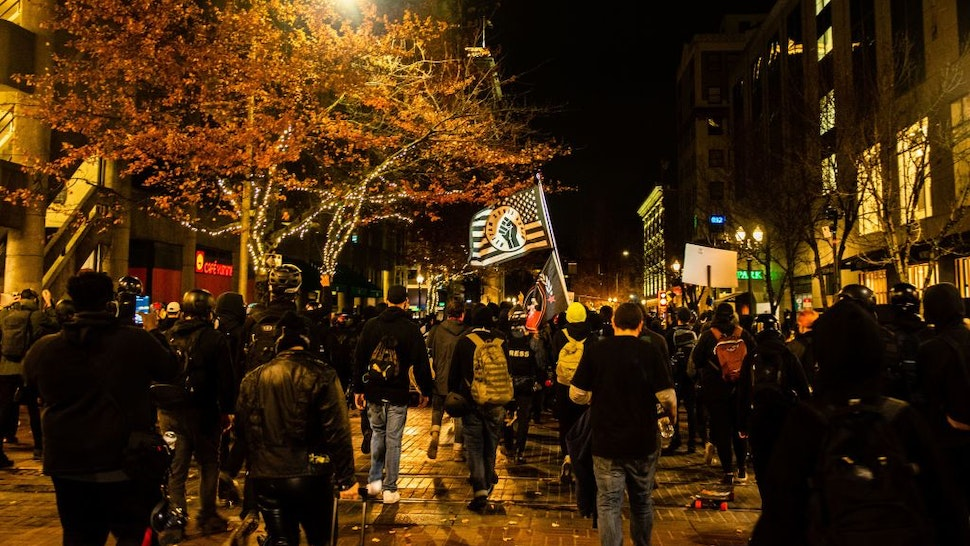 """Portland city protestors march in Portland, Oregon on November 4, 2020, during a demonstration called by the """"Black Lives Matter"""" movement, a day after the US Presidential Election. - Democratic"""