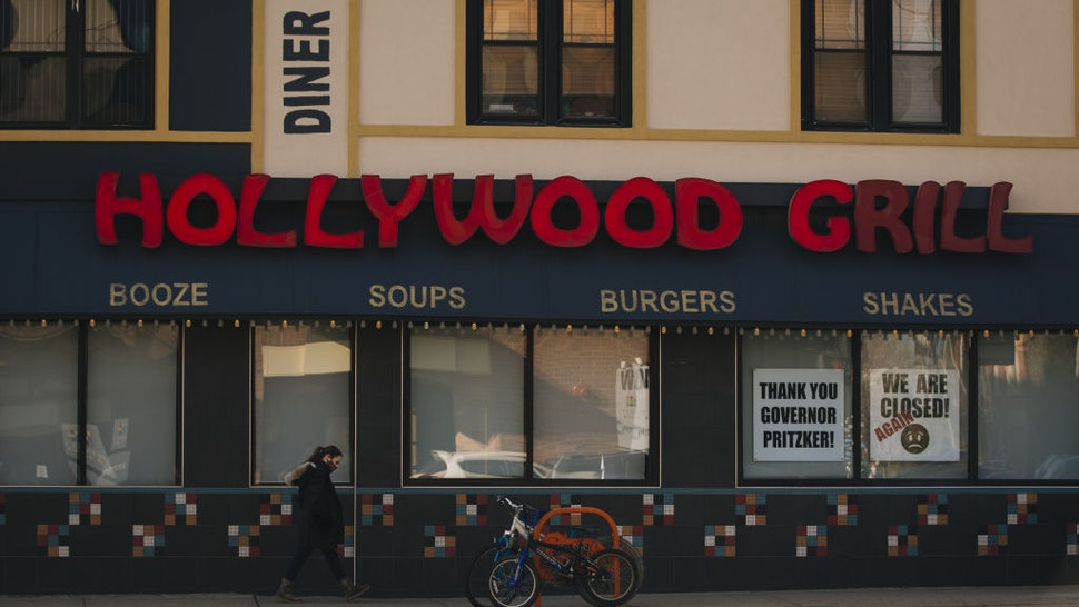 """Signs outside a restaurant read """"Thank you Governor Pritzker!"""" and """"We are Closed! Again"""" in Chicago, Illinois, U.S., on Friday, Nov. 13, 2020."""