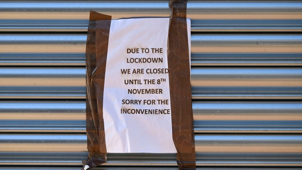 A sign on the shutters of a closed business on November 6, 2020 in Merthyr Tydfil, Wales.