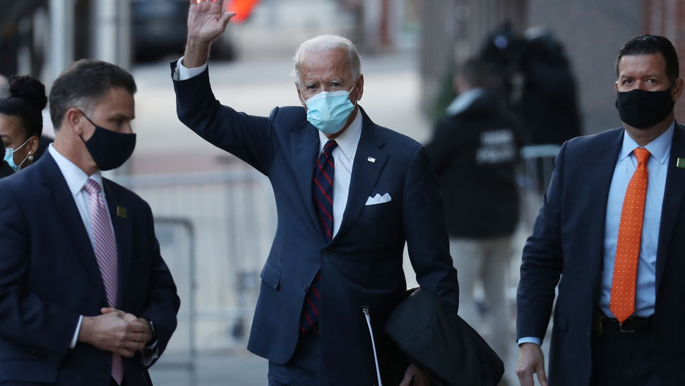U.S. President-elect Joe Biden waves as he leaves the Queen Theater after receiving a briefing on national security wiith advisors on November 17, 2020 in Wilmington, Delaware.