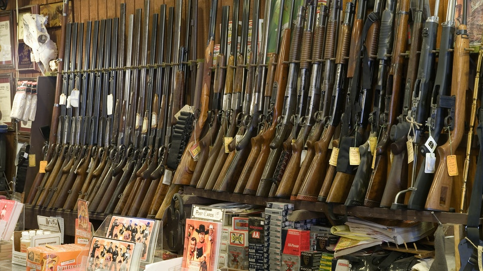 Guns on rack in store, close-up - stock photo