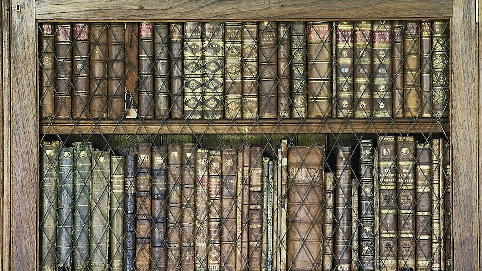 Bookcase with books, library in Abbotsford House, home of the writer Sir Walter Scott, Melrose, Scotland, United Kingdom.