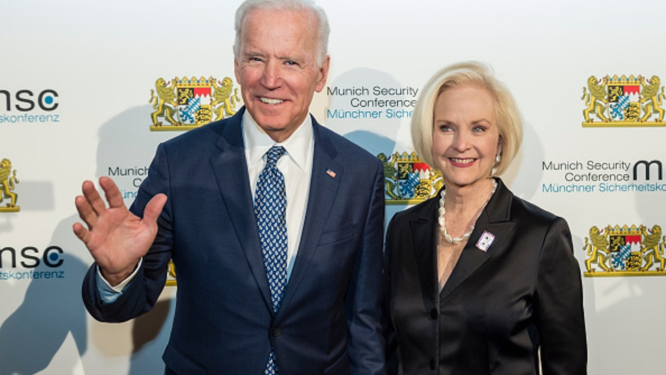 dpatop - Former US Vice President Joe Biden, and Cindy McCain, arrive at the reception of the Bavarian State Chancellery during the 54th Munich Security Conference in Munich, Germany, 17 February 2018. Photo: Andreas Gebert/dpa