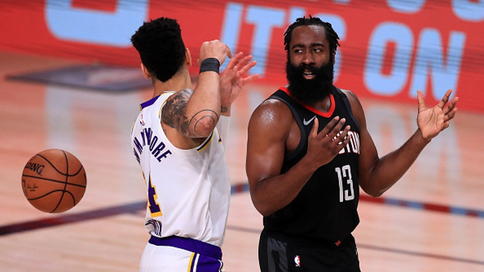 LAKE BUENA VISTA, FLORIDA - SEPTEMBER 12: James Harden #13 of the Houston Rockets reacts with Danny Green #14 of the Los Angeles Lakers during the third quarter in Game Five of the Western Conference Second Round during the 2020 NBA Playoffs at AdventHealth Arena at the ESPN Wide World Of Sports Complex on September 12, 2020 in Lake Buena Vista, Florida. NOTE TO USER: User expressly acknowledges and agrees that, by downloading and or using this photograph, User is consenting to the terms and conditions of the Getty Images License Agreement.