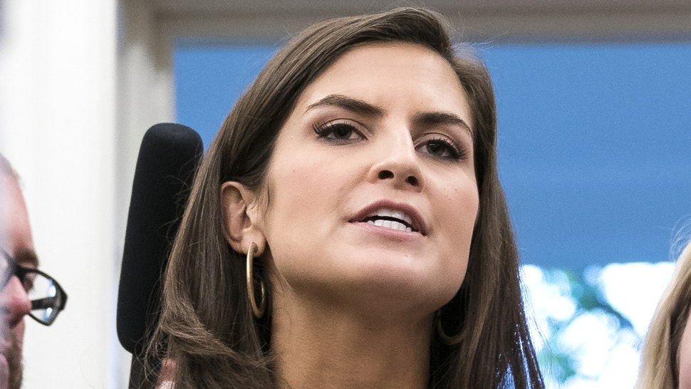 WASHINGTON, DC - JULY 30 : CNN White House Correspondent Kaitlan Collins asks questions of President Donald J. Trump as the press is escorted out after a swearing-in ceremony for the new Secretary of the Department of Veterans Affairs Robert Wilkie in the Oval Office at the White House on Monday, July 30, 2018 in Washington, DC.