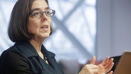 Kate Brown, governor of Oregon, speaks during an interview in Portland, Oregon, U.S. on Wednesday, Jan. 20, 2016. Brown, a Democrat, joined the state House of Representatives in 1991, was later elected to the Senate and served as secretary of state since 2009, before taking over as governor in February.