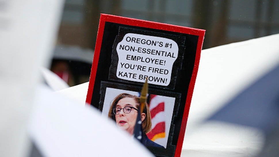 SALEM, OR - MAY 02: A sign criticizing Oregon Governor Kate Brown is seen at the ReOpen Oregon Rally on May 2, 2020 in Salem, Oregon. Demonstrators gathered at the state capitol to demand a reopening of the state and to protest Gov. Kate Brown's stay-at-home order which was put in place to slow the spread of the coronavirus