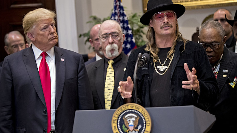 "Musician Kid Rock, right, speaks as U.S. President Donald Trump, left, listens during a signing ceremony for H.R. 1551, the Hatch-Goodlatte Music Modernization Act, in the Roosevelt Room of the White House in Washington, D.C., U.S., on Thursday, Oct. 11, 2018. Trump on Wednesday said the ""Fed has gone crazy"" with interest-rate increases this year and doubled-down on Thursday, blaming the nation's ""out of control"" central bank for a sixth straight day of losses in U.S. equities. Still, he said, ""I'm not going to fire him."""