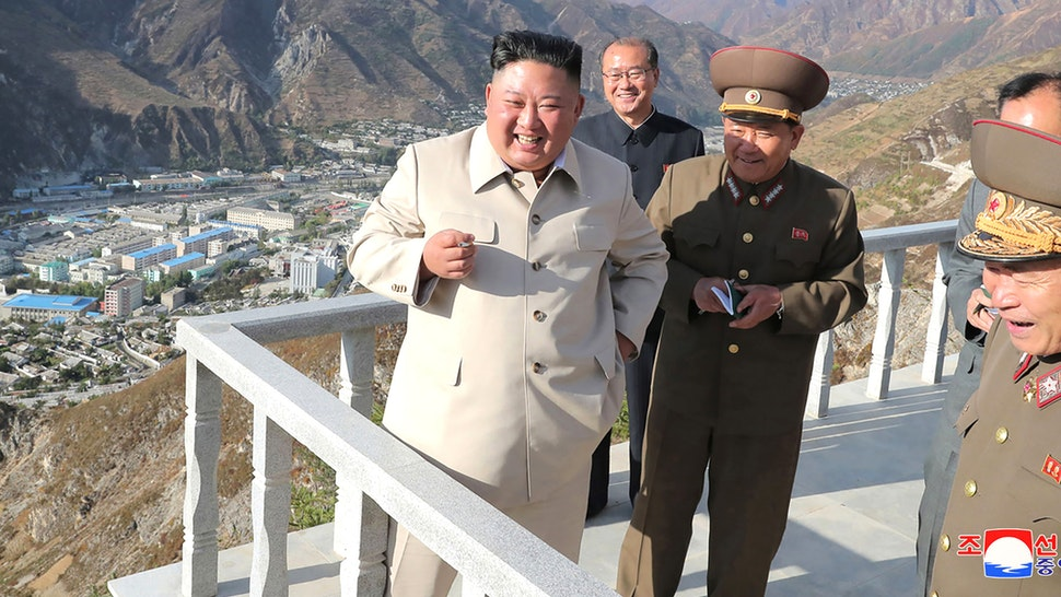 This undated picture released from North Korea's official Korean Central News Agency (KCNA) on October 14, 2020 shows North Korean leader Kim Jong Un (L) inspecting the rehabilitation site in the Komdok area of South Hamgyong Province, which was damaged by the typhoon.