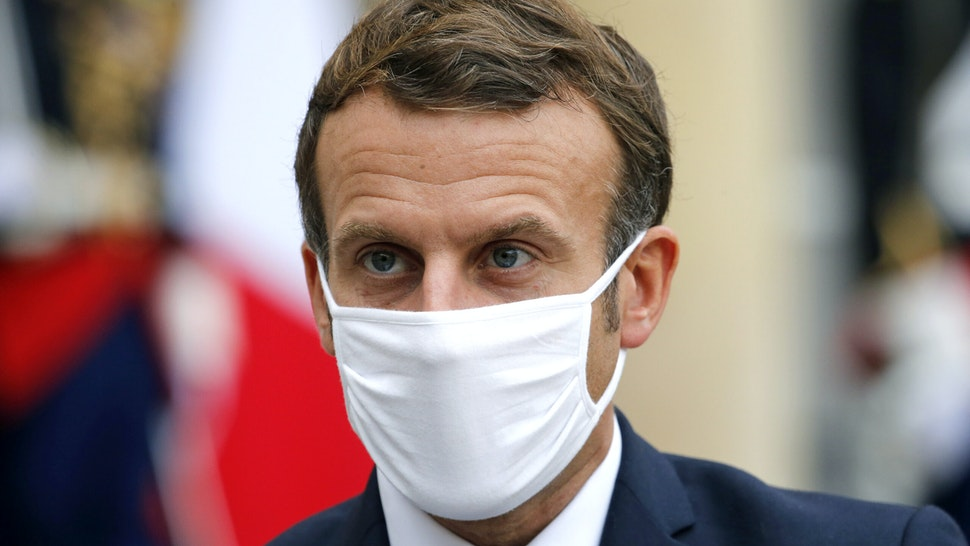 """PARIS, FRANCE - OCTOBER 28: French President Emmanuel Macron wearing a protective face mask looks on as he makes a statement next to Estonian Prime Minister Juri Ratas following their meeting at the Elysee Palace on October 28, 2020 in Paris, France. Emmanuel Macron will speak this evening at 8 p.m. from the Elysee Palace, in an official speech to address the French to announce """"difficult measures"""". The President of the Republic and the government consider that faced with the sudden worsening of the Covid epidemic in France, containment measures are necessary."""
