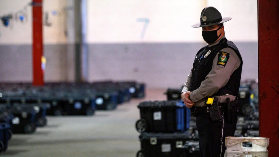 PITTSBURGH, PA - NOVEMBER 04: Election precinct suitcases containing ballots, election materials and keys to voting machines are held under guard by the Allegheny County Police at the Allegheny County elections warehouse on November 4, 2020 in Pittsburgh, Pennsylvania. Election officials continue to count absentee ballots in critical battleground states, including Pennsylvania, Michigan and Wisconsin.