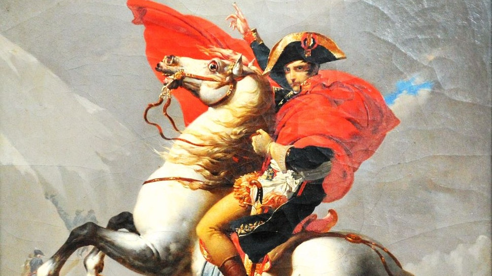 Workers present the oil painting of Napoleon Bonaparte Crossing the Alps by the French artist Jacques-Louis David for an art show featuring the French emporer in Qingdao in east China's Shandong province Tuesday, Aug. 04, 2020. Nearly 200 artifacts, most of which lent from French collector Pierre Jean Chalencion, will be shown till mid-November.