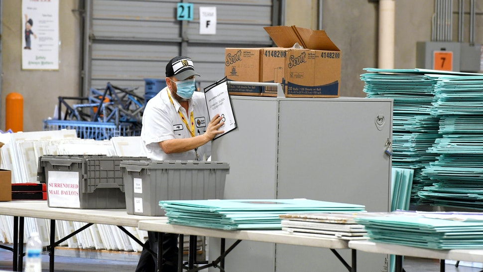 NORTH LAS VEGAS, NEVADA - NOVEMBER 05: Polling place equipment and materials are processed at the Clark County Election Department on November 5, 2020 in North Las Vegas, Nevada. Donald Trump and Joe Biden remain in a tight race in the battleground state, which is still too close to call after Tuesday's election.