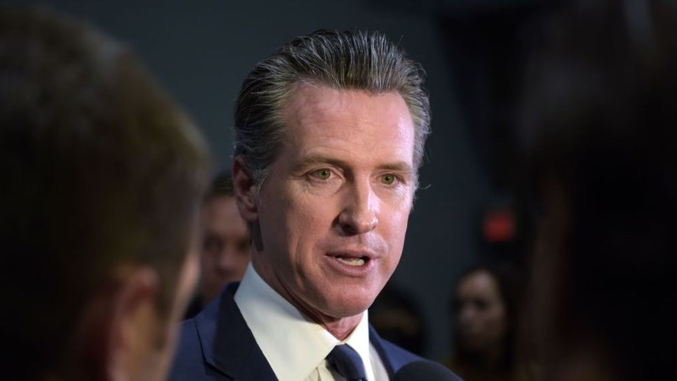 California Governor Gavin Newsom speaks to the press in the spin room after the sixth Democratic primary debate of the 2020 presidential campaign season co-hosted by PBS NewsHour & Politico at Loyola Marymount University in Los Angeles, California on December 19, 2019.