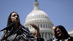 Representative Alexandria Ocasio-Cortez, a Democrat from New York, speaks during a news conference announcing college affordability legislation on Capitol Hill in Washington, D.C., U.S., on Monday, June 24, 2019. Democratic presidential hopeful Bernie Sanders is proposing to cancel the nation's outstanding $1.6 trillion of student debt and offsetting the cost with a tax on Wall Street transactions. Photographer: Andrew Harrer/Bloomberg