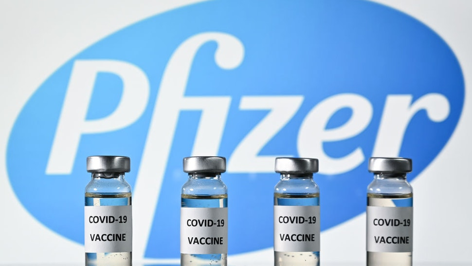 An illustration picture shows vials with Covid-19 Vaccine stickers attached, with the logo of US pharmaceutical company Pfizer, on November 17, 2020.