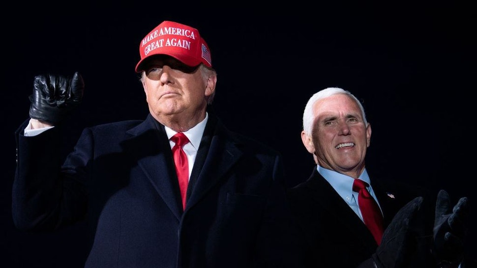 US President Donald Trump arrives with US Vice President Mike Pence for a Make America Great Again rally at Cherry Capital Airport in Traverse City, Michigan on November 2, 2020. (Photo by Brendan Smialowski / AFP) (Photo by BRENDAN SMIALOWSKI/AFP via Getty Images)