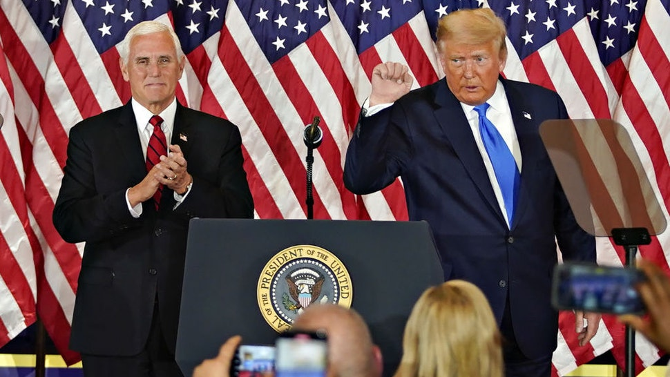 U.S. President Donald Trump gestures after speaking during an election night party with U.S. Vice President Mike Pence, left, in the East Room of the White House in Washington, D.C., U.S., on Wednesday, Nov. 4, 2020. Trump declared he had won re-election against Joe Biden and said he would ask the Supreme Court to intervene, even as several battleground states continue to count votes. Photographer: Al Drago/Bloomberg