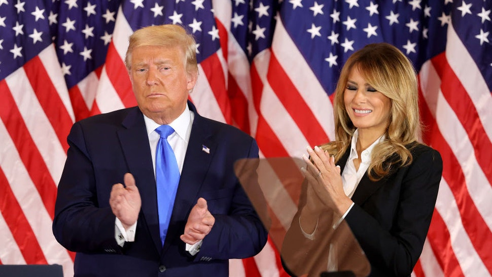 WASHINGTON, DC - NOVEMBER 04: U.S. President Donald Trump and first lady Melania Trump take the stage on election night in the East Room of the White House in the early morning hours of November 04, 2020 in Washington, DC. Trump spoke shortly after 2am with the presidential race against Democratic presidential nominee Joe Biden still too close to call. (Photo by Chip Somodevilla/Getty Images)