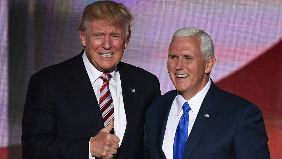 Republican presidential candidate Donald Trump (L)gives the thumbs-up as he stands with vice presidential candidate Mike Pence at the end of the third day of the Republican National Convention at the Quicken Loans Arena in Cleveland, Ohio on July 20, 2016. (Photo credit should read TIMOTHY A. CLARY/AFP via Getty Images)