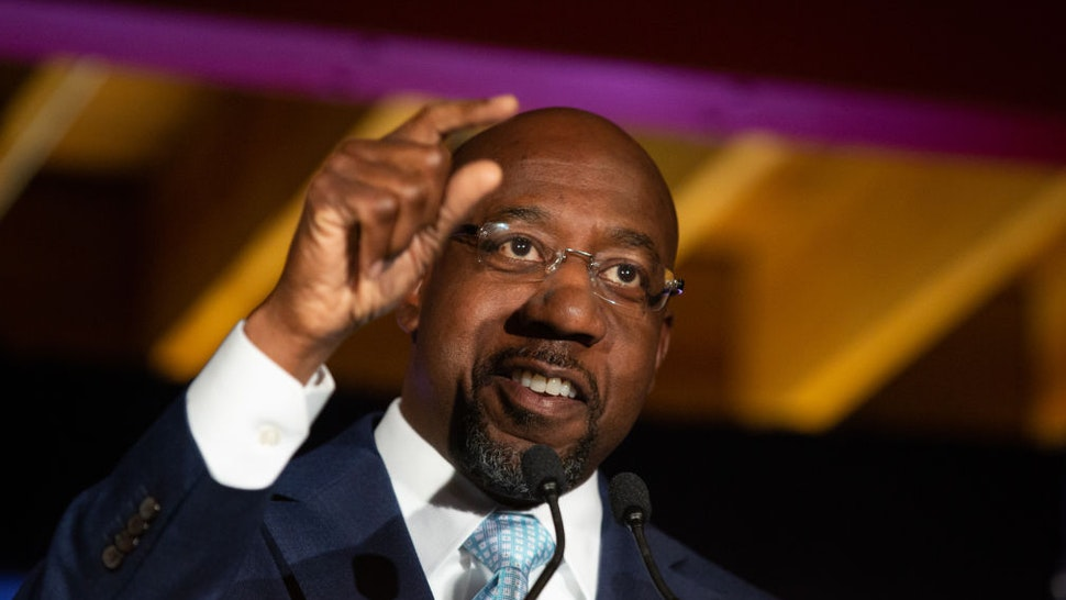 Democratic U.S. Senate candidate Rev. Raphael Warnock speaks during an Election Night event on November 3, 2020 in Atlanta, Georgia. Democratic Senate candidate Rev. Raphael Warnock is running in a special election against a crowded field, including U.S. Sen. Kelly Loeffler (R-GA), who was appointed by Gov. Brian Kemp to replace Johnny Isakson at the end of last year. Georgia is the only state with two Senate seats on the November 3 ballot. (Photo by Jessica McGowan/Getty Images)