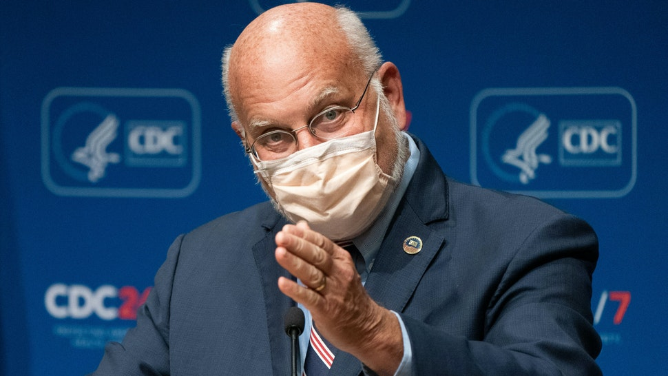 """Robert Redfield, director of the Centers for Disease Control and Prevention (CDC), speaks during a news conference at the CDC Roybal Campus in Atlanta, Georgia, U.S., on Wednesday, Oct. 21, 2020. The Centers for Disease Control and Prevention expandedthe definition of """"close contact"""" to someone with a confirmed case of Covid-19 to include repeated, brief encounters."""
