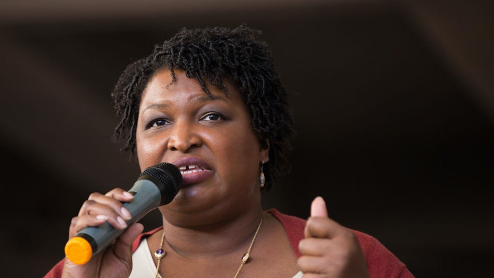 """ATLANTA, GA - OCTOBER 28: Democratic Georgia Gubernatorial candidate Stacey Abrams talks to a crowd gathered for the """"Souls to The Polls"""" march in downtown Atlanta on October 28, 2018 in Atlanta, Georgia. Alongside artist Common and Ambassador Andrew Young, Abrams marched with voters to a polling station open for early voting in downtown Atlanta."""