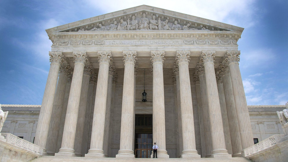 A police officer stands guard on the steps of the US Supreme Court in Washington, DC, June 15, 2017.