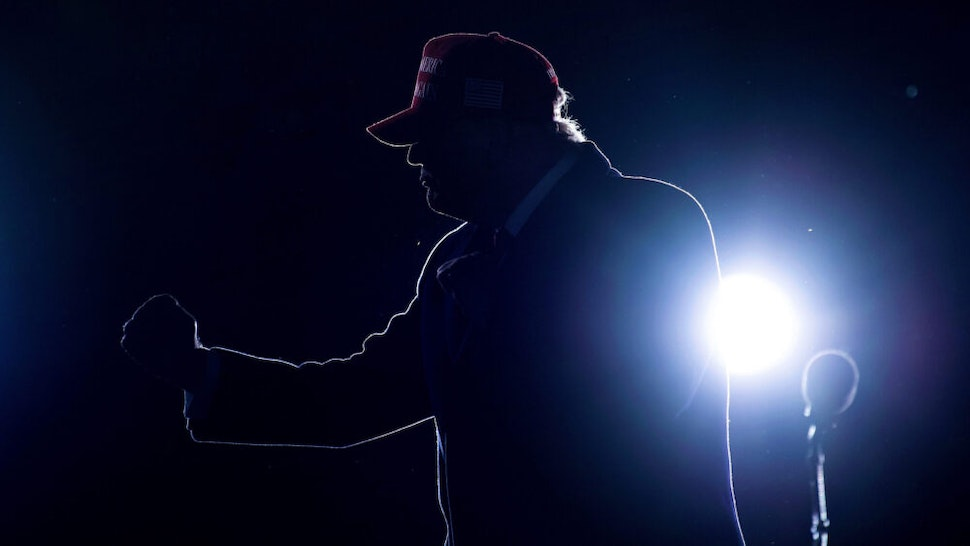TOPSHOT - US President Donald Trump dances after speaking during a Make America Great Again rally at Richard B. Russell Airport in Rome, Georgia on November 1, 2020.