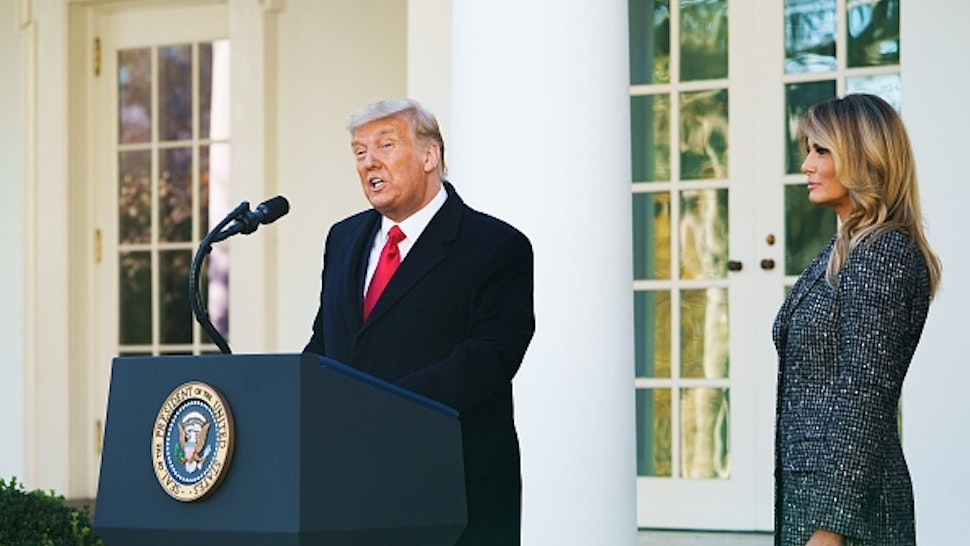 US President Donald Trump speaks during the annual Thanksgiving turkey pardon watched by First Lady Melania Trump in the Rose Garden of the White House in Washington, DC on November 24, 2020.